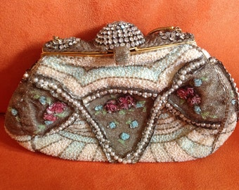 Vintage beaded purse with faux pearls and rhinestones with a small mirror on the top of the frame