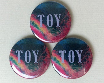 "TOY ""First"" Pinback Button"