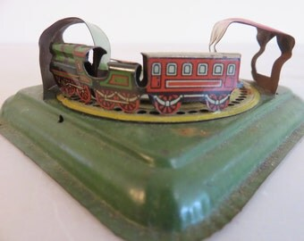 Vintage handheld train toy, 1920s era