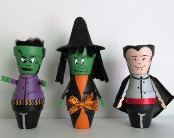 Hand-Painted Miniature Clay Pot Shelf-sitter Figurines, featuring Frankenstein, a Witch, and a Vampire, set of 3