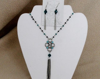 Hand made chaining black and turquoise necklace and matching earrings.