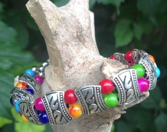 Multi-color beaded bracelet with metal accent beads