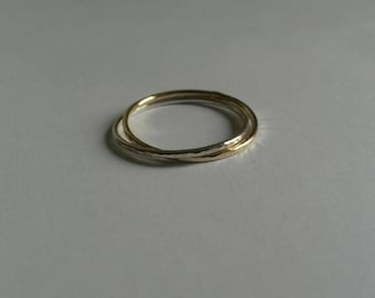 Silver and gold fine and modern hammered ring with 2 interlace rings.