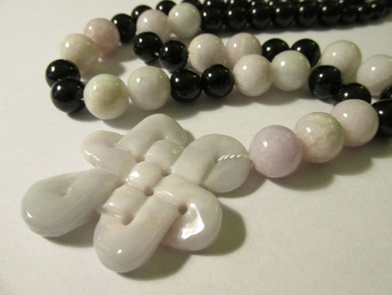 infinity knot jade pendant with jade and black onyx