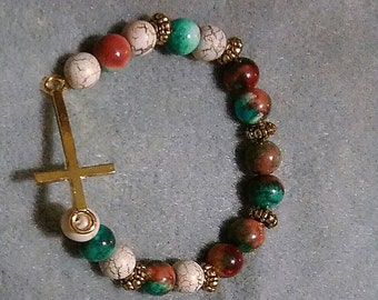 Knitted bracelet with cross
