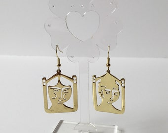 Man and woman brass earrings