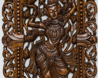 "2 wall carvings of dancing girl each 23 1/2"" wide and 47 1/2"" long and 1 3/8"" thick, hand carved in solid teak"
