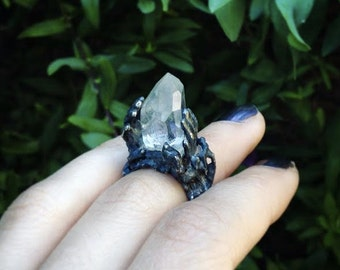 Silver ring with rock crystal in hands