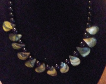 Necklace with Abalone shells with black beads.