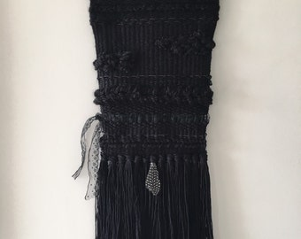Monochrome black wall weaving, lace feather