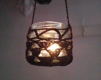 Morrocan style crochet hanging jar cover.