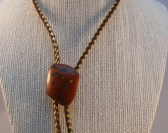 Vintage bollo tie with brecciated jasper concho