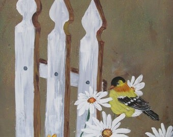 Yellow finch on picket fence surrounded by daisies