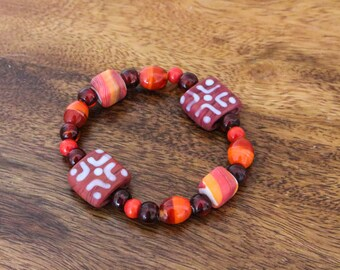 Elasticated red beaded bracelet