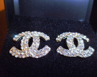 Gold and crystal fashion cc earrings in box,brand new!