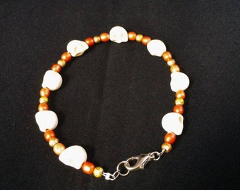 Orange and Gold Beaded Skull Bracelet