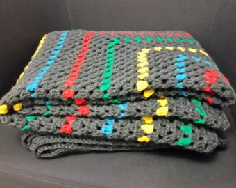Primary dream, crocheted dark grey,yellow, green, turquoise and burnt orange blanket/throw