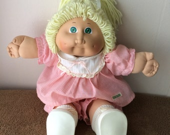 Cabbage Patch Kids doll, blond hair, blue eyes, pink clothes, vintage 1985