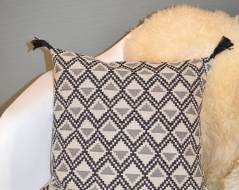 Ethnic chic cushion with PomPoms