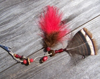 Roach clip, Red woodland feather