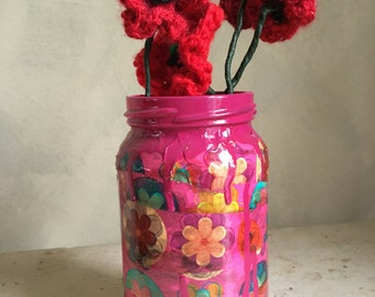 Hand-painted 'Wrapped Up' upcycled glass jar.