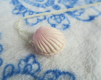 Pastel pink shell necklace with hidden pearl