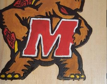 U.M wooden plaque