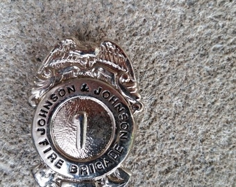 Vintage Johnson & Johnson Fire Brigade badge #1 from New Brunswick New Jersey mint never used!!!