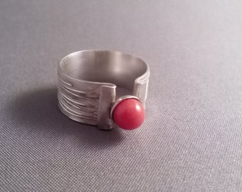 Silver ring with red coral