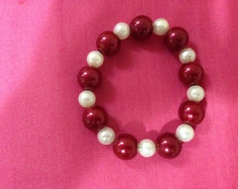 maroon and white bracelet