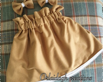 Suedette skirt with matching bow clips