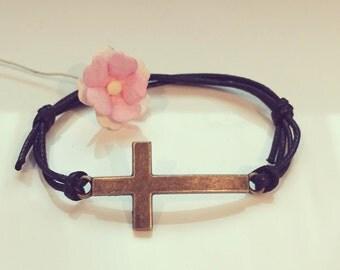 Cross on a bracelet in black, faith, hope, hope