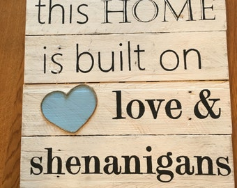 This home is built on love and shenanigans sign