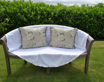 Large floral rectangle cushions, with pom pom trim.