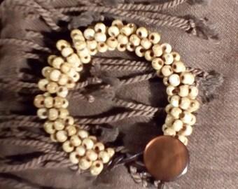 wrap around bracelet with vintage button closure