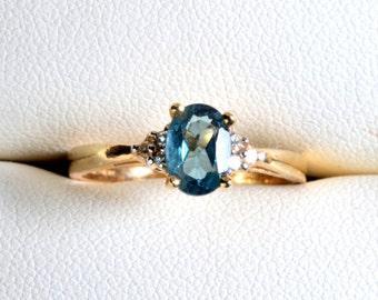 Ladies 14K Yellow Gold London Blue Topaz / Diamond Ring