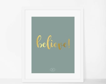 """The """"believe"""" print in gold."""