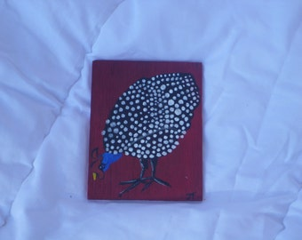 paintings on wood; Guinea fowl