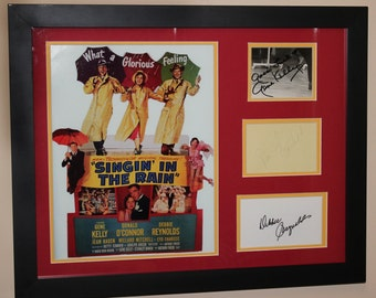 Singin' in the Rain (3) Signed Authentic Matted Display w/ Gene Kelly ,Donald O'Connor and Debbie Reynolds Framed