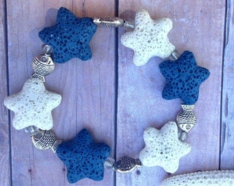 Blue and white lava starfish beaded beacelet, silver fish spacers.