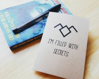 I'm filled with secrets. Secret notebook inspired by Twin Peaks. A6 with recycled cover.