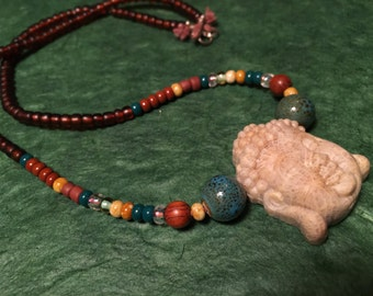 Carved Coral Fossil Buddha Hemp Necklace