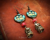 To Grandma's Hose - Inspired by the Little Red Riding Hood, Danita designed and crafted an earring pair with a metal merry go round charm.
