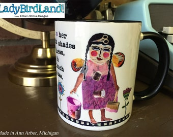 She colors her world with shades of kindness, bravery and just a touch of kick ass- Coffee Mug