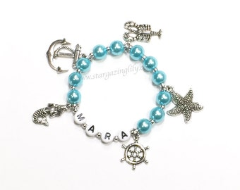 Nautical themed Multi Charm Bracelet YOU CHOOSE 5 charms, the pearl color, name. Personalized Anchor Charm Bracelet Mermaid Charm Bracelet
