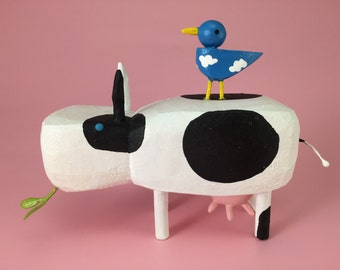 cow with bluebird buddy