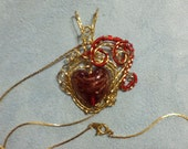 Gorgeous gold and red heart woven in beautiful golden brass