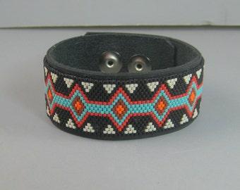 Native American beaded bracelet, leather cuff bracelet, peyote stitched bracelet, black red blue bracelet, seed bead bracelet, tribal