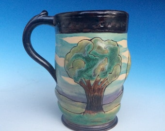 Arts and crafts style landscape mug