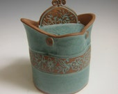 ON SALE 25% Off with Coupon code covered jar blue green verdigris glaze with batik flower pattern on red clay